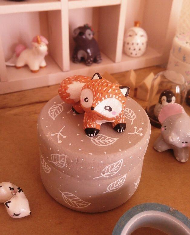 Boite avec figurine renard