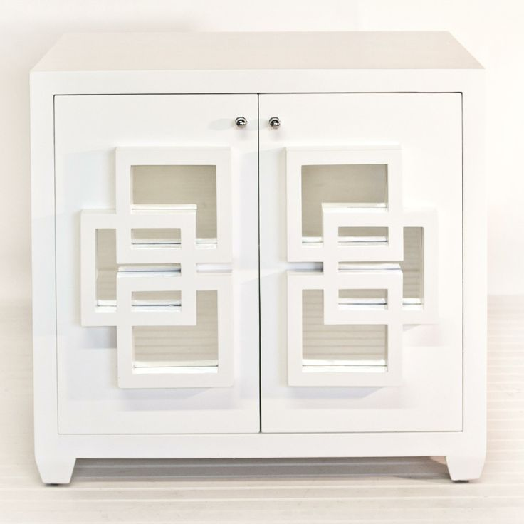 Two door cabinet in white lacquer with one fixed interior shelf.  Inset mirrored squares on front doors of cabinet.
