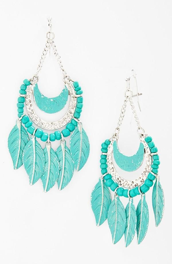 Adding turquoise feather earrings to the festival wardrobe!