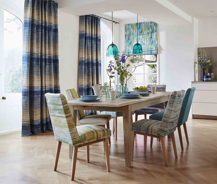 Create a bright and airy dining room with an ocean inspired colour palette in…