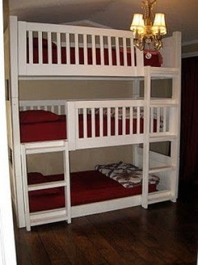 Triple Bunk Beds  - but i would put a dresser where the bottom bunk i and build the two bunks above it with the ladder on the side/end