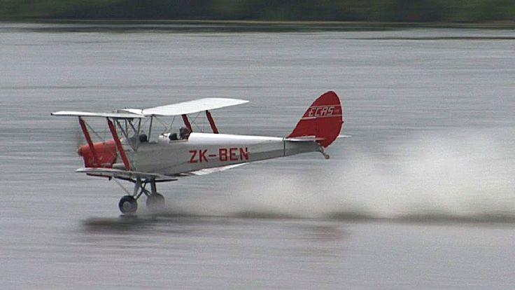 Tiger Moth biplane waterskiing on lake - like skimming stones