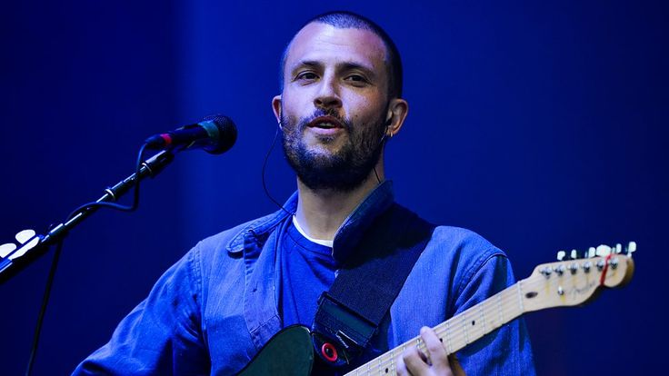 Orlando Weeks of The Maccabees. One of the most stylish bands of the last decade, Orlando rocked his workwear jacket on stage this year at Glastonbury.