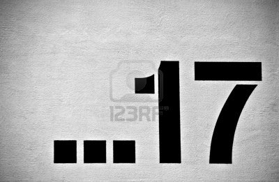 a number on a urban wall in black and white Stock Photo