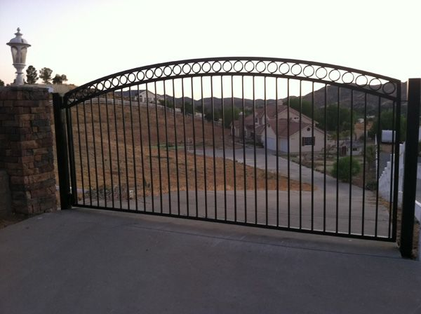Ranch driveway entrances vinyl fence driveway gates in for Motorized driveway gate price