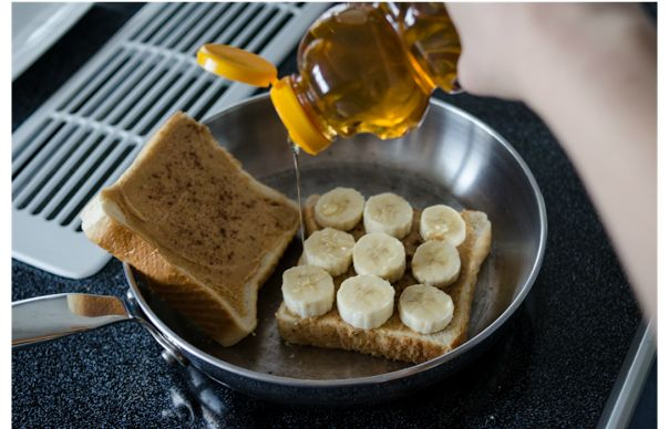 Delicious and simple recipe for a Peanut Butter and Banana Grilled Sandwich with honey. Plus six more easy peanut butter recipes!