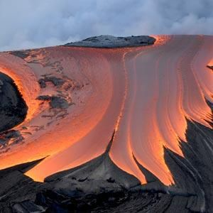 Kilauea Volcano (home of Madame Pele, Goddess of Fire) Description: A river of lava entering the Pacific Ocean.