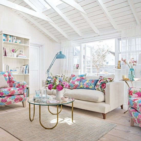 White country-style living room with floral soft furnishings