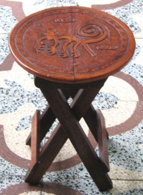 Brown stool with a graved leather seat, Inca Design from Peru