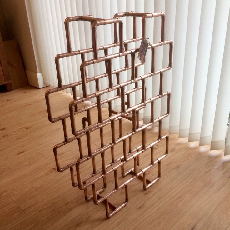A labour of love, 24 bottle wine rack, built for a custom order. 146 pipe fittings and more than 340 individual soldered joints. I hope they like it.