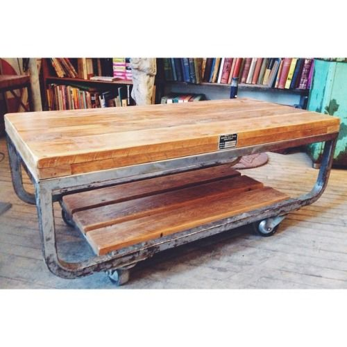 """This is the prettiest coffee table I've seen in a while! So, it's a vintage Canada Post Office Mail cart, that we refurbished and turned into a coffee table. The wood is salvaged from a @m3cdemolitionto demolition job site. It measures 44"""" x 20.25"""""""