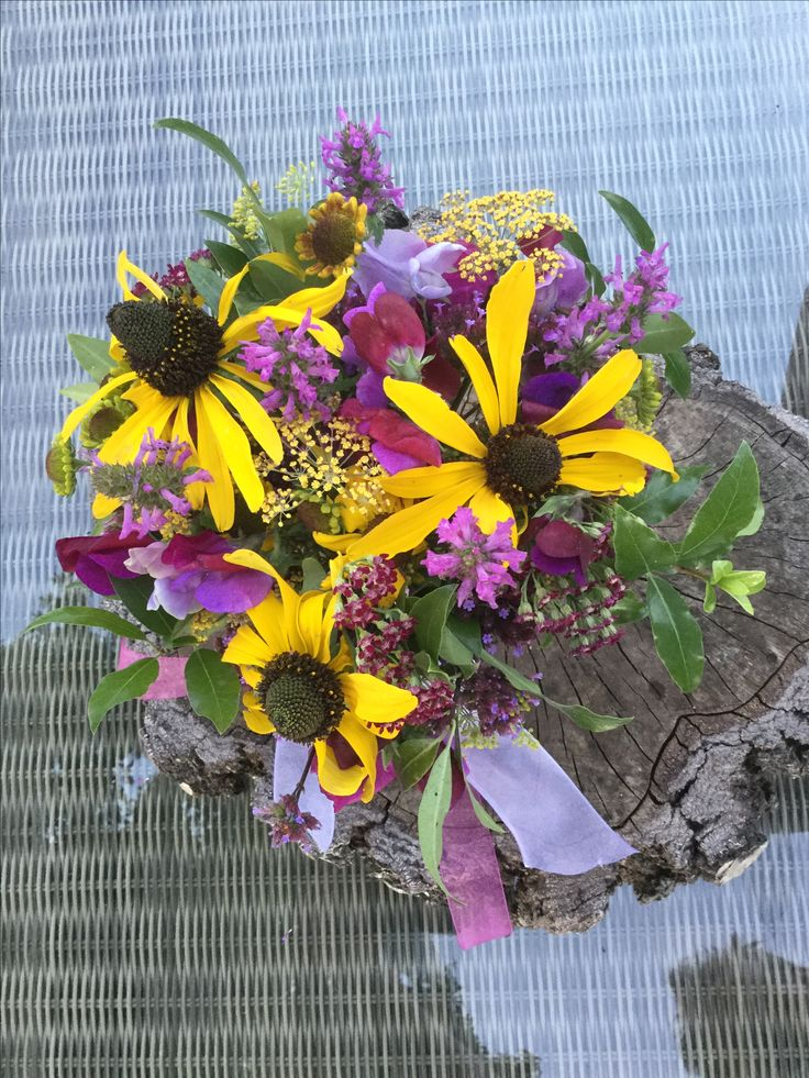 British flowers#Wedding bouquet, # All homegrown , #cut from our cottage garden in Herefordshire # Rudbeckia # Sweet peas # Alchillea. # Mixed foliage # Wonderfully scented # Chiffon ribbons All enquiries email :- vick@bloominglovelyflowersandplants.co.uk
