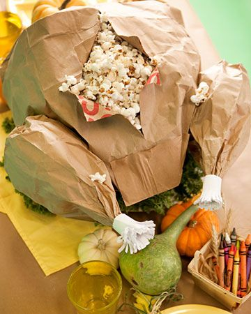 """This is a wonderful idea for the kids table at the thanksgiving dinner!  Paper-Bag Turkey  """"Carve"""" this turkey to discover the popcorn surprise inside. A large paper grocery bag forms the body and small lunch bags form the legs. The only turkey that would make it on our table ;-)"""