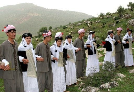 Yazidis, a religious minority centered in the Iraqi Kurdistan region, wear traditional clothes.
