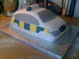 Here's a brief step-by-step of the Police Car cake I made for a 5 year old's birthday party... First make two chocolate cakes. Stick th...