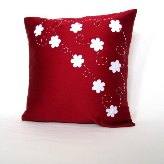 White flowered red cushion