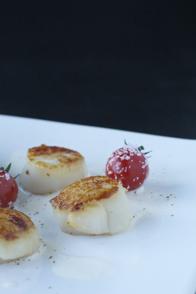Scallops in vodka and lemon grass sauce and black pasta