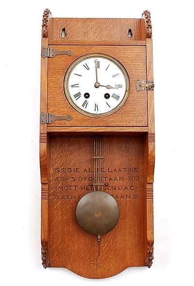 Found on www.botterweg.com - Wooden Nieuwe Kunst wall clock with pendulum clock with carved text Die al te laat is opgestaan moet heel den dag een drafje gaan with hand-carved ornament edges at bottom- and topside designer execution unknown the Netherlands ca.1910
