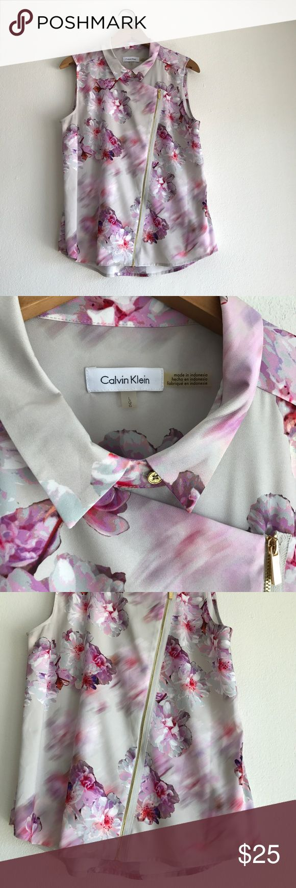 Calvin Klein Sheer Floral Zip-Up Blouse Size Large Gently used.  Beautiful Floral sheer material.  Asymmetrical zipper up the front with 2 gold colored buttons at the neck.  Can be worn as a vest or tank top.  100% Polyester Calvin Klein Tops Blouses