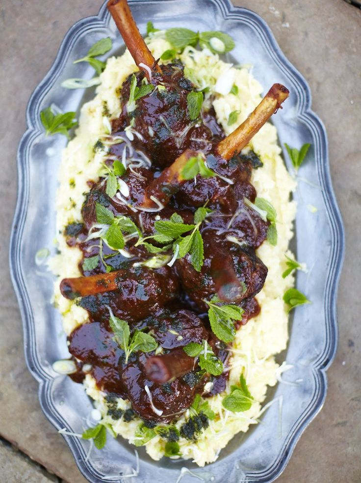 Guinness lamb shank.  Jamie Oliver.  his recipe is all about investing in dark sticky sauce and tender meat. We're spoiled for choice when it comes to interesting ales, and adding a good dark ale or even Guinness to the onions creates the most brilliant depth of flavour.