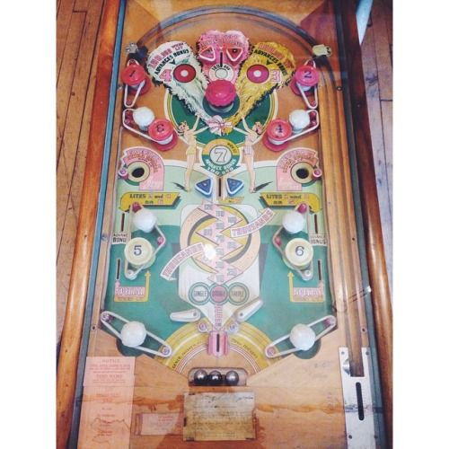 hree Feathers pinball machine made in the late 1940's, hand crafted, hand painted. Unfortunately the mechanics are not working, so we re-purposed this into a coffee table. Email us for a price