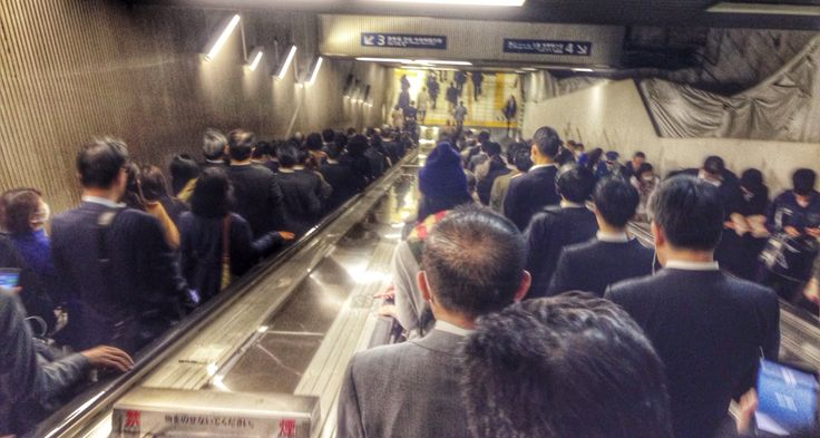 Just a normal day at the subway with all these salary men  :)   In Tokyo, Japan