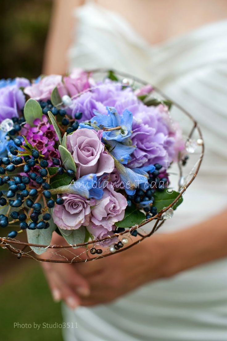 Pearls and crystals surround this wedding bouquet.