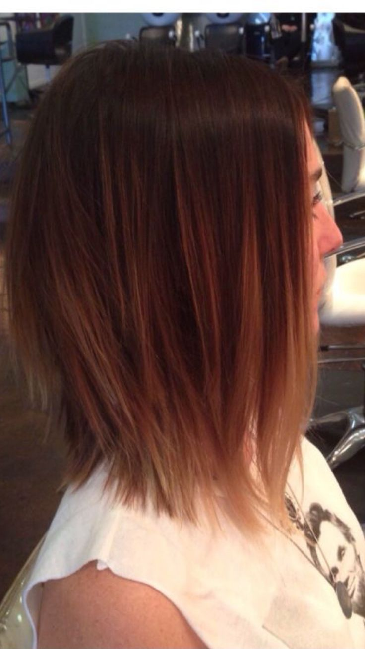 Razored, textured ends on medium length bob.