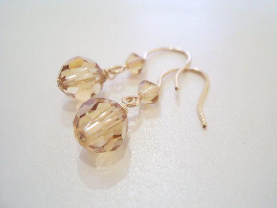 Swarovski golden petite dangly earrings in gold filled brass