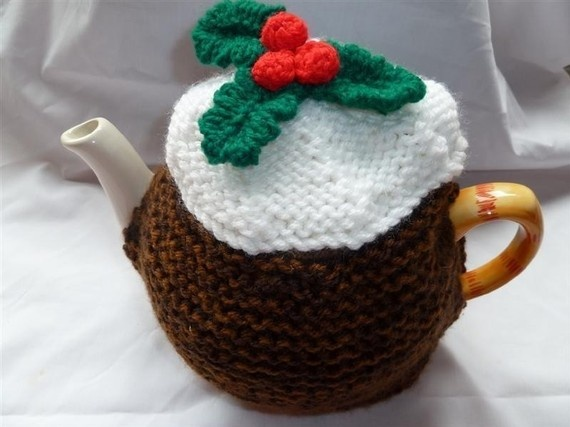 hand knitted christmas pudding tea cosy    knitted with 2 strands throughout to keep your tea pot hot    will fit medium pot(4-6)cups  £12.00