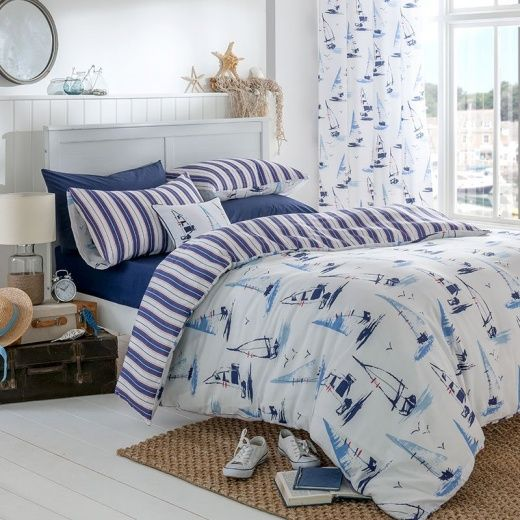 The Catherine Lansfield Duvet Cover Set Features A Nautical Sailing Boats Design With Striped Reverse