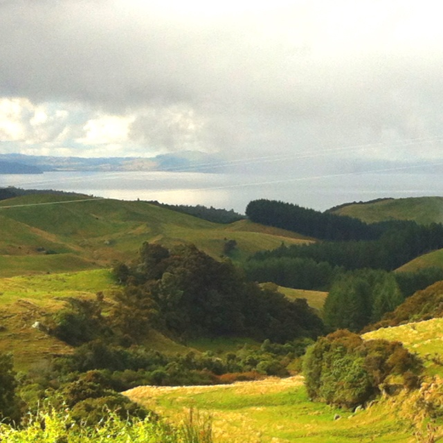 Sunlight and showers on the hills above Southern lake Taupo in the center of New Zealand's North island.