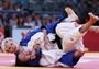 Urska Zolnir of Slovenia (blue) competing with Xu Lili of China    Xu Lili of China (white) competes with Urska Zolnir of Slovenia in the women's -63 kg Judo final on Day 4 of the London 2012 Olympic Games at ExCeL.Photos - 2012 Olympics   London 2012