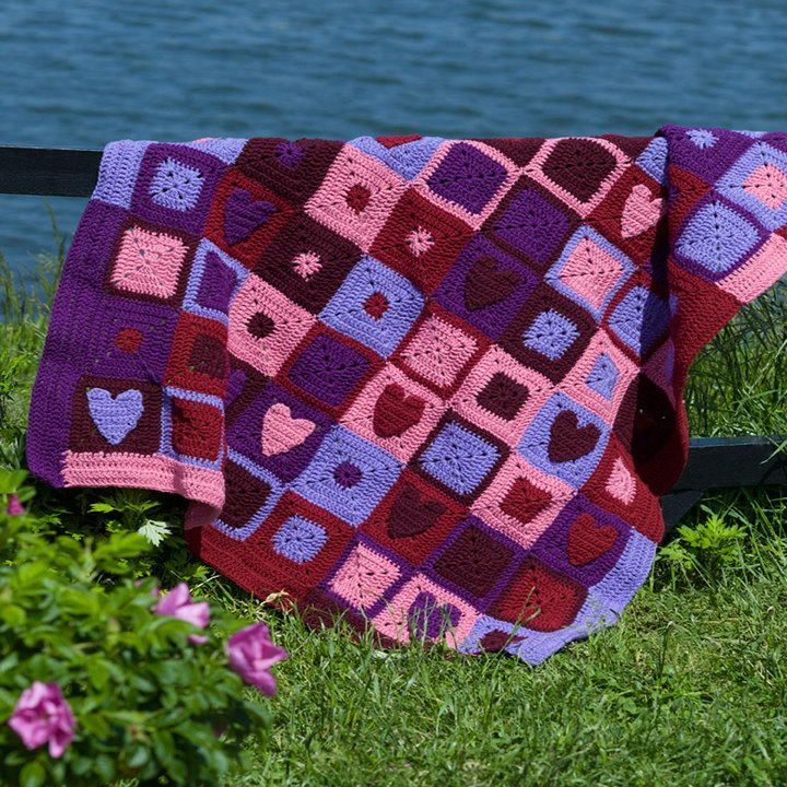 Happy Hearts Crochet Afghan | Use crochet granny squares with hearts to work up this Valentine's afghan
