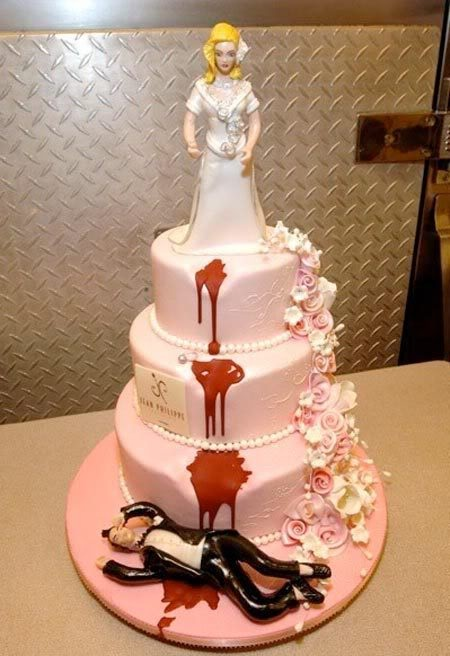 Divorce cake. Well, this is..umm..an interesting wedding cake. I am sure that every bride needs this one. :)