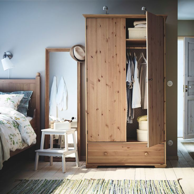 A bedroom with HURDAL wardrobe and bed in solid pine, and a STABEKK mirror with a solid wood frame- 2015