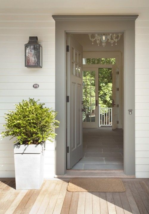 "Like these colors and style. Front door: hallway extends from front of house to back; bluestone ""runner"" is also used on front walk and continues out on to patio in back. Connection between front and back of house. Also like the chandelier."