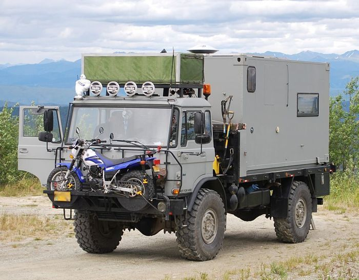 """Unimog 4x4, cab roof rack, trail lighting, dirtbike """"lifeboat"""", brush guard, snorkeled, shovels, hi-boy jacks (2), onboard compressed air- two tanks, so the starter may be air powered, very handy in case of EMP or Nuke as vehicle requires no electricity to run, living quarters are built into a 20' container that can be lifted off for flatbed or stationary use, survival UNIT!"""