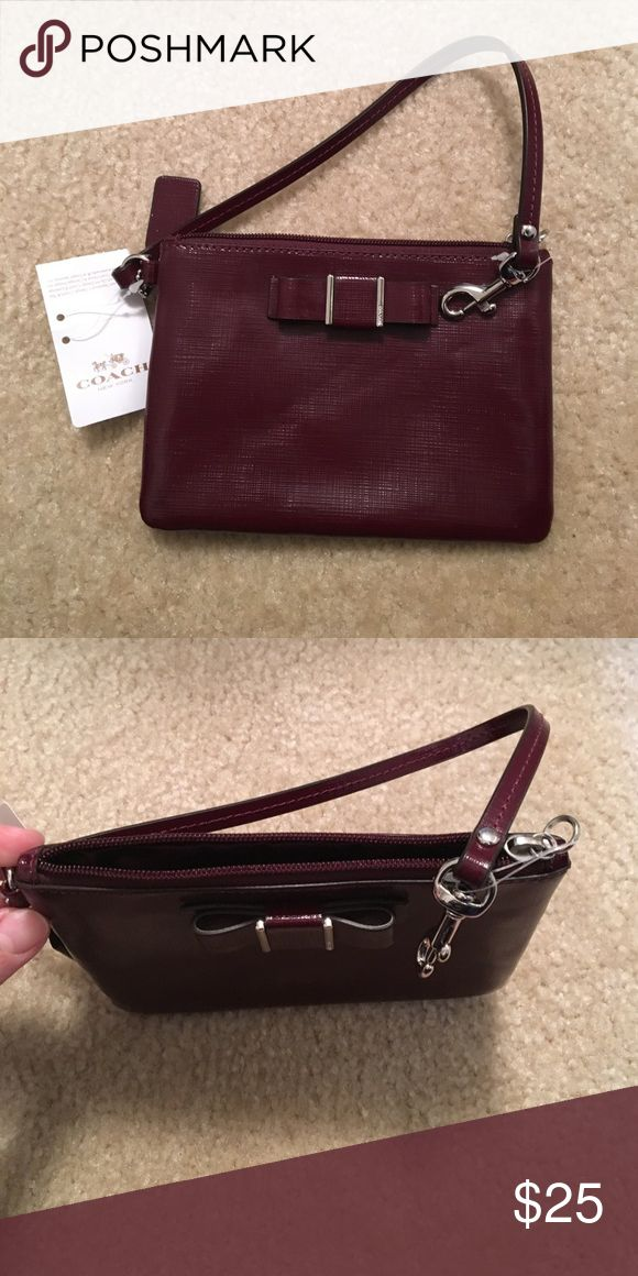 Small coach clutch *new with tag* Burgundy, small coach clutch, never been used. Coach Bags Clutches & Wristlets