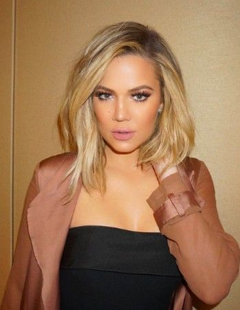 We are obsessed with Khloe Kardashian's new lob cut! Here are our some of our fave pics of her! | PRIMPED