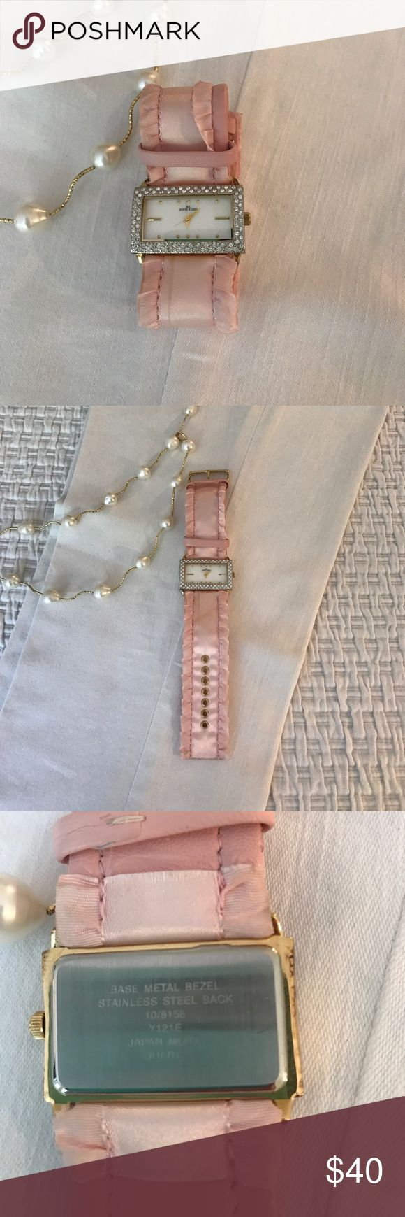 Gorgeous Anne Klein pink satin rhinestone watch Have you read about the new developments in the Anne Klein line? For Anne Klein watch lovers like myself, here is no need for a revival because they are always awesome and run forever. I love this sweet watch and I put in a new battery and it's ready to walk around and get some compliments. Guaranteed authentic. The back reads: base metal bezel, stainless steel back, Japan Movt. No scratches on face. Anne Klein Accessories Watches