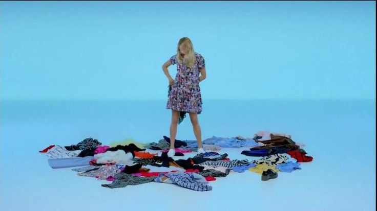 "Set against a soft blue background and with the soft beat of the song ""Gold"" by Kiiara, this Apple Watch commercial shows actress Chloë Sevigny trying on different outfits from the pile of clothes laid out on the floor. From the leather jacket to the light blue denim button-up shirt and floral dress, she is pulling off every look. And, the music seems to keep her in the groove the entire time."