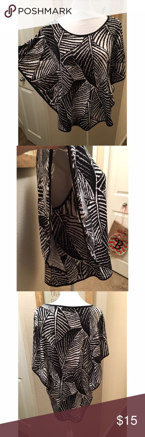 """New York & Company top Lovely top by New York & Company 🌺 features black and white pattern with """"open"""" batwing type sleeves. There is an elastic band in the back and the top goes slightly longer in the back too. Great over black leggings. In excellent used condition. New York & Company Tops Blouses"""