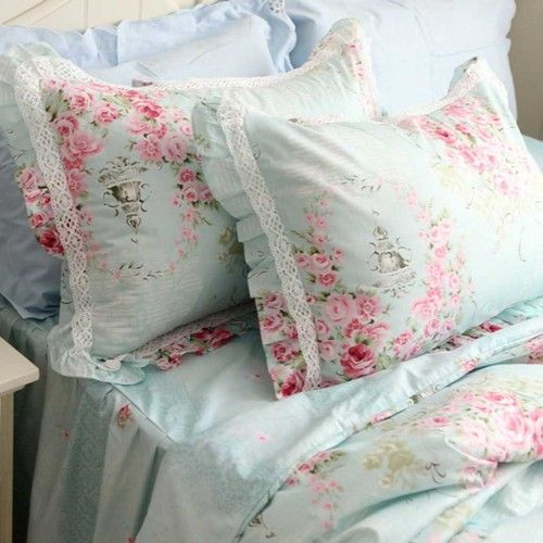 The pink roses on the light aqua sheets and pillowcases make such a restful bed.