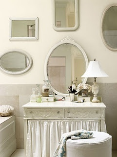 Love the wall of mirrors and pretty vanity!