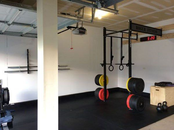 Very nice rogue equipped garage gym clean and
