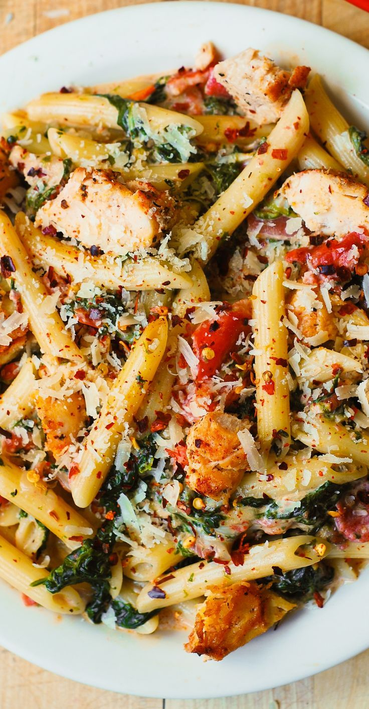Chicken and Bacon Pasta with Spinach and Tomatoes in Garlic Cream Sauce  delicious creamy sauce perfectly blends together all the flavors: bacon, garlic, spices, tomatoes. (chicken dinner recipes)