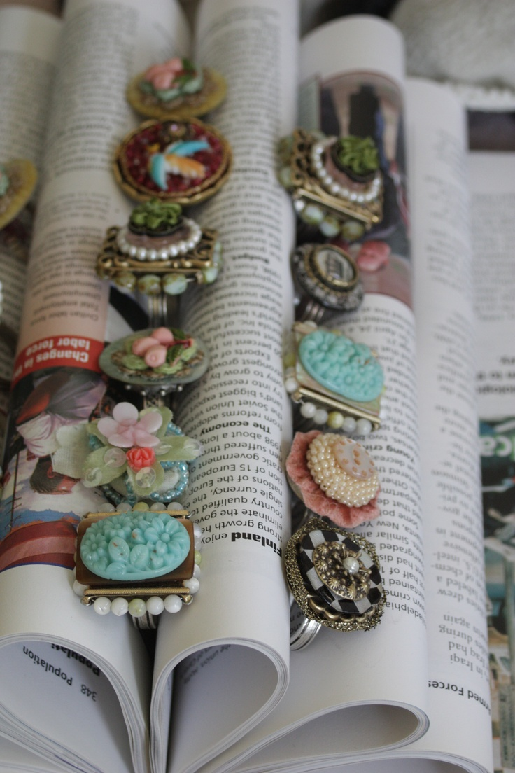Display rings & jewelry on the folded pages of a repurposed old book, for arts and crafts show booth, retail store display or cottage style home decor; Upcycle, Recycle, Salvage, diy, thrift, flea, repurpose!  For vintage ideas and goods shop at Estate ReSale & ReDesign, Bonita Springs, FL