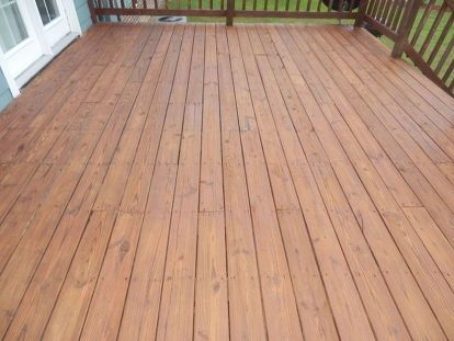 deck makeover big change for 250 00, decks, outdoor living, Yep it has rained on it and no problem
