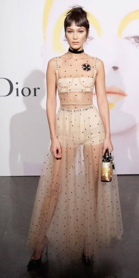 Bella Hadid went nearly nude at Dior Beauty's celebration of The Art of Color with Peter Philips in see-through embroidered nude tulle Dior dress, which revealed nude knit lingerie.